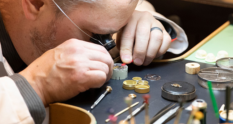Watchmaker working on a watch